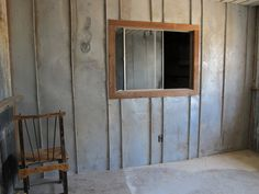 Reclaimed Space, metal wall, reclaimed wood window case....love this reclaimed stuff!