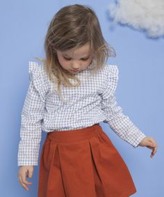 Frilly sleeve blouse and rust box skirt
