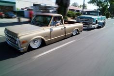 """""""Nacho"""" pulling """"Sancho""""  Both trucks out of Delmo's Speed Shop."""