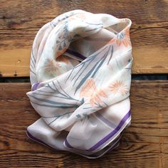 """This is a silk chiffon scarf with Leah's """"Harriet"""" design.   - 36"""" x 36"""" - 100% silk - hemmed on four sides - hand wash - iron as needed  Made in the USA."""