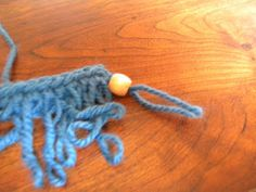 Learn to make loop stitch fringe with beads.