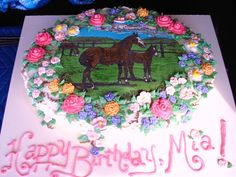 """Mare and Foal with Flowers Birthday Cake - My first paying cake order!  My husband's little cousin Mia wanted a """"mommy horse and a baby horse that are brown with lots of flowers"""" cake for her 6th birthday.  Hope she enjoys it!  Cake is vanilla with vanilla buttercream and royal icing flowers (except for the roses, which are buttercream)."""