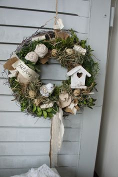 An enchantingly beautiful door wreath with rustic charm ., A magically beautiful door wreath with a rustic, graceful charm . On a wreath tied with moss and vines you will find hand-tied / sewn fabric roses . Diy Spring Wreath, Easter Wreaths, Diy Wreath, Holiday Wreaths, Door Wreaths, Grapevine Wreath, Easter Flower Arrangements, Mothers Day Wreath, Fabric Roses