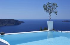 """Memories of the bright summer at the """"Athermi Apartments Santorini""""... Time passes by fast, soon the hot sun of summer will make you want to stay in this pool gazing at the Aegean Sea all day long... (Antonis Eleftherakis Photography)"""