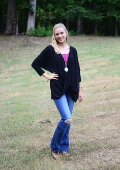 This black twist-front top is perfect for Fall! Pair with burgandy tank top and jeans for a complete seasonal look. Shop now at Hip Chics Boutique!