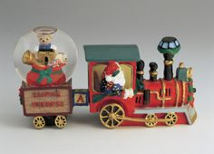 Close-up of a figurine of a Santa Claus in a train with gifts