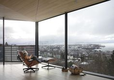 Another angle on the city view from an #Eames lounge chair and ottoman by @vitra