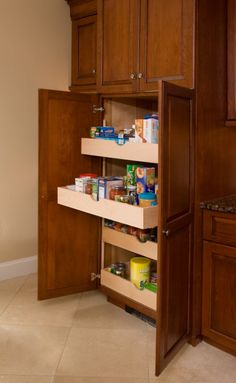 I love these pull out shelves for kitchen cabinets. How can you forget what is in the back if your cabinets if you can actually see it!