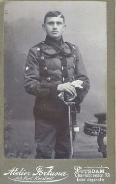 Leib Garde Husar trooper wearing the signal crossed flags on his right sleeve.