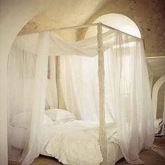 dreamy bed - the posts look like they are made from driftwood