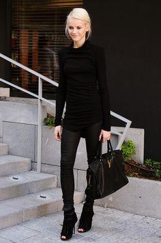 blonde hair, black clothes.