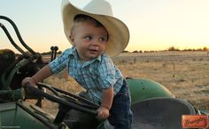 Look at this little cowboy on his Big Green Tractor #WranglerInTraining #LongLiveCowboys