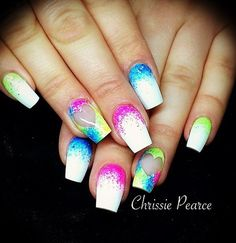 A cuticle watercolor nail art design. This design starts off with a white base color which also serves as a French tip. The watercolor polish is then painted as close as possible from the nail cuticle towards the middle of the nail.