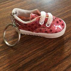 Tennis shoe key purse ring new Super cute pink glitzy tennis shoe key purse ring new without tags. Accessories Key & Card Holders