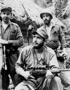 Raul Castro, left, stands to his brother and then rebel leader Fidel Castro, bottom as they operate against dictator Fulgencio Batista from Cuba's eastern mountains in 1957. Photo: AP Photo/Andrew St. George