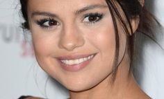 Research finds that a smile makes a person look younger and trimmer. As evidence, we offer Selena Gomez.