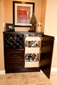 Wine Rack and drawers in space next to refridgerator