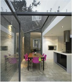 LIKE - exposed brick wall (simple), expanse of glass, tall simple opening to back lounge (if not possible to incorporate small lounge into expanded kitchen in my house), polished concrete floor's not bad.
