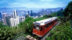 Scenic Victoria tram overlooking the Hong Kong skyline.