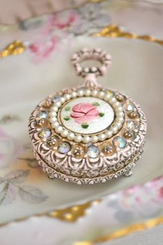 Floral Pearl and Gold Pocket Watch...