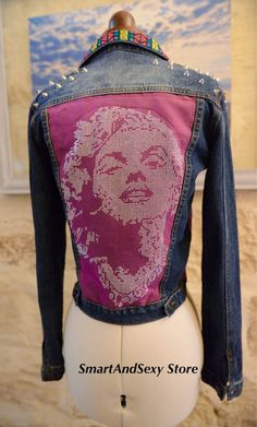 This lovely jean jacket has a great pattern on the back making it very feminine and unusual. The theme from the collar features on the front sides