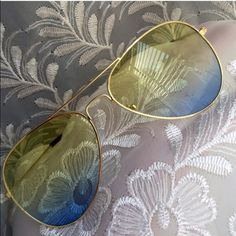 """Yellow & Blue Ombre Lens Aviators Yellow and blue ombre lenses. Gold frames . Black arm/ear guards. Approximately 5.75"""" across frame front, 2 x 2.75"""" each lens frame. Fit not guaranteed. Images 2, 3, 4 show example of actual stocked glasses. Brand new retail w/o tag. Lens cloth included. No case. No trades, no holding, no offsite payment.     ❗️PRICE IS FIRM UNLESS BUNDLED❗️                  Bundle and save  Accessories Glasses"""