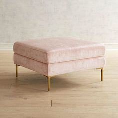 Modern in design but classic in comfort, our Barrett Ottoman combines the best of past and present. It's handcrafted with clean lines, clad in blush-toned velvet and supported by hardwood legs. Plus, it's luxe and a vital part of your future relaxation.