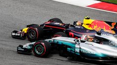 Max Verstappen Red Bull Racing RB13 and Lewis Hamilton Mercedes-Benz F1 W08 Hybrid battle at Malaysian Grand Prix - Sunday 1 October 2017