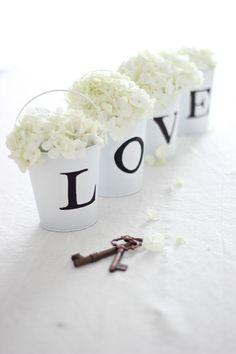 22 Eye-Catching & Inexpensive DIY Wedding Centerpieces: Love Buckets Centerpiece Idea | thegoodstuff