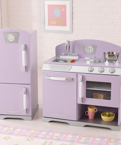 This retro lavender kitchen set sports sweet finishes and matching functional doors on the refrigerator, freezer, oven, sink and dishwasher. It even features knobs on the appliances and a removable sink for easy cleanup.Includes refrigerator and sink/stoveStove: 25.9'' W x 26.7'' H x 14.2'' DRefrigerator: 12.3'' W x 31....