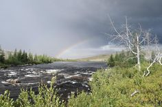Rainbow peaking out of thunderstorm Labrador Canada [1185 x 790] [OC] #reddit