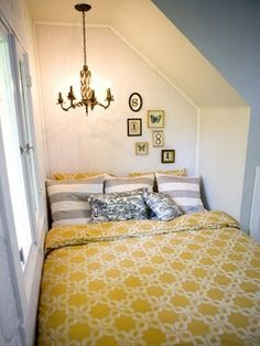 Love the yellow/grey bedding and coziness.