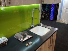 Exhibition unit that was made for the Home Makers Expo. Showcasing Corian tops with integrated draining grooves. Green splashback done by Crafty Cupboards and high gloss doors. Corian Top, Splashback, Cupboards, Cabinet Doors, 3d Design, Homemaking, High Gloss, Kitchen Remodel, Kitchen Design