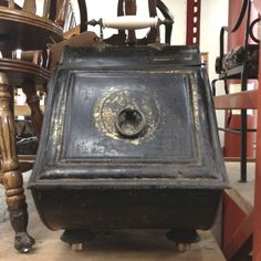 old coal holder that would be a good holder for pellets for pellet stove