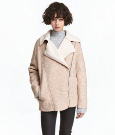 Light beige melange. Jacket in felted wool-blend fabric with a diagonal zip at front. Notched lapels, yoke at back, side pockets, and zip at cuffs.