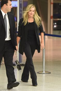 Low key departure:Margot Robbie kept things simple as she flew out of New York on Wednesd...