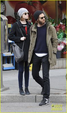 Emma Stone and Andrew Garfield hold hands while taking a casual stroll on Tuesday (November 25) in New York City's West Village.