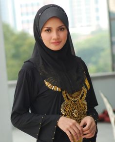 A Muslim woman... prim and proper and so precious like rare pearls. Yes, that's what we are!