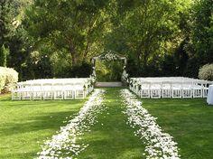 Gorgeous white rose petal ceremony aisle!