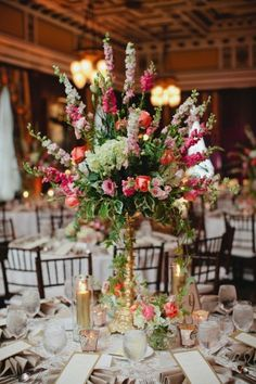 Pink and White Delphinium Ivy and Stock Tall Wedding Centerpiece