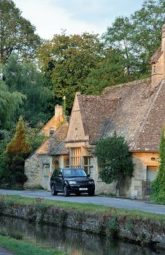 The pictureque village of Lower Slaughter, Gloucestershire, is known for its unspoilt limestone cottages in the traditional Cotswold style. Lower Slaughter sits beside a stream, and its name derives from the Old English word 'slough' (for wetland) or 'slothre' (for muddy place).