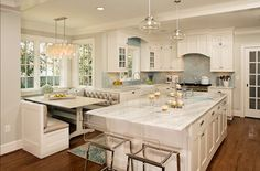 Gorgeous kitchen - would prefer the stools on the long side of the island and either no banquette or one where the seats don't stick out so far, but very fond of the style and layout in general.