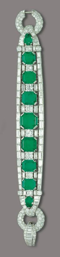 AN ART DECO EMERALD AND DIAMOND BRACELET. Designed as a line of nine graduated rectangular-cut and pear-shaped emeralds alternating with brilliant and baguette-cut diamond spacers, within lines of baguette-cut diamonds, to the pavé-set diamond bombé ring clasp, 1930s, 19.5 cm, with French assay mark for platinum.