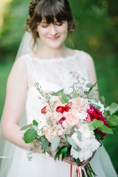 pink and red bouquet, photo by Jeffrey C. Gleason Photography http://ruffledblog.com/natural-romantic-wedding-with-macrame-details #weddingbouquet #flowers