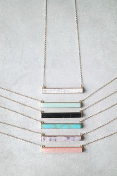 """Add a pop of color to your look with this stylish stone bar necklace. Details: - 27"""" + 3"""" extender - Gold plated - Lobster closure clasp"""