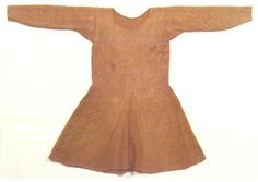 Museum reconstruction of the Bocksten Tunic. Surviving bog find, carbon dated to the 14th century.