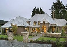 Plan W69460AM: Photo Gallery, Corner Lot, Luxury, European, Premium Collection, French Country House Plans & Home Designs
