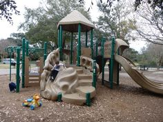 Old Braeswood Park with 2 playground structures and lots of donated (??) Push Toys