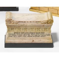 A Sienna marble inkwell in the form of Scipio's tomb height 4 1/4 in.; width 6 3/4 in.