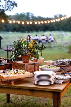 Outdoor Party string lights, pile the plates and head outdoors